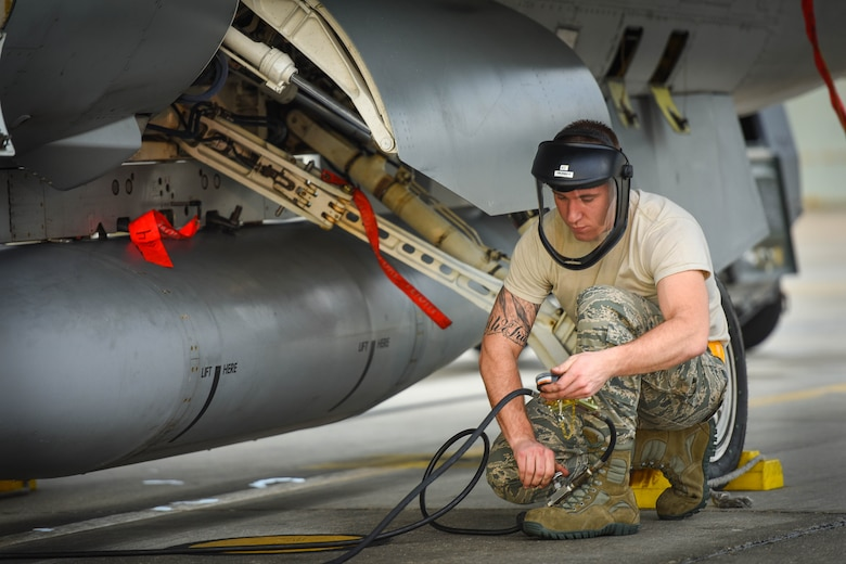 Senior Airman Josh Miller inflates tires of an F-16C Fighting Falcon Jan.12, 2015, on the flight line of Naval Station Key West, Boca Chica Island, Florida. The 180th Fighter Wing deployed to Key West, Florida, to conduct aircraft training with F-5's from the Naval Station Key West, and F-15 Eagle's from the 159th Fighter Wing in New Orleans, Louisiana. Miller is a 180th Fighter Wing crew chief. (U.S. Air National Guard photo/Staff Sgt. Amber Williams)