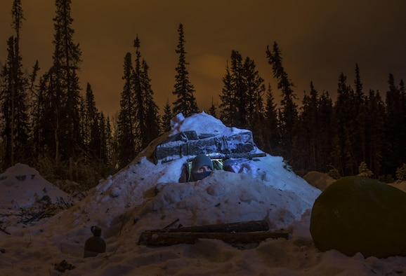 Airman 1st Class Ray Simon  looks out of his thermalized A-frame tent during arctic survival school Jan. 15, 2015, near Eielson Air Force Base, Alaska. The thermalized A-frame is designed to keep survivors warm and dry in arctic environments. Simon is a 3rd Maintenance Support Squadron crew chief. The story about Arctic Survival School will be published in the February issue of Airman magazine. To find out more information or to read other Airman stories, visit http://airman.dodlive.mil.  (U.S. Air Force photo/Staff Sgt. Vernon Young Jr.)