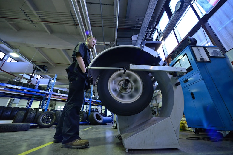 Airman 1st Class Austin Conway checks the pressure in a tire Jan. 14, 2015, at Ramstein Air Base, Germany. The 86th Vehicle Readiness Squadron is responsible for servicing more than 1000 vehicles on and off base. Conway is a 86th VRS general purpose light vehicle mechanic. (U.S. Air Force photo/Senior Airman Nicole Sikorski)