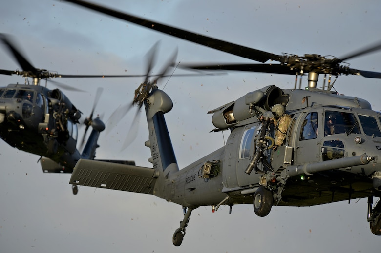 Two 56th Rescue Squadron HH-60G Pave Hawks respond in a combat search and rescue scenario Jan. 16, 2015, on Royal Air Force Lakenheath, England. Unlike other rescue squadrons, the 56th RQS is the only unit with a dedicated combat search and rescue force to conduct personnel recovery for a joint force. (U.S. Air Force photo/Airman 1st Class Trevor T. McBride)