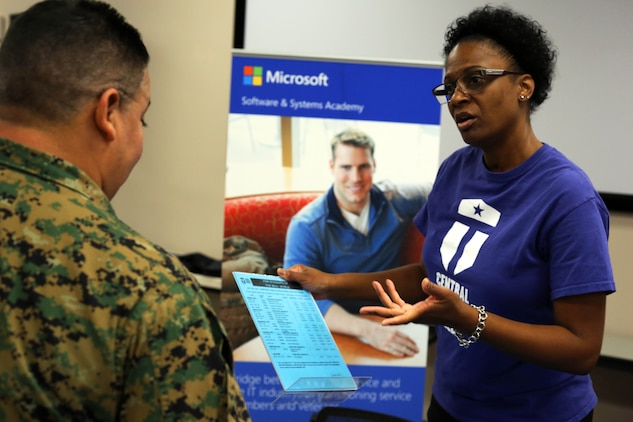 Michelle Howard, right, shares information about some of the education opportunities that are available to Marines during a Transition Resource Fair held, here, by the Personal and Professional Development Branch of Marine and Family Programs Jan. 22.