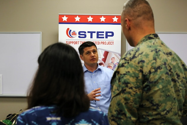 Steve McClelland, center, shares information about the services Support The Enlisted Project offers Marines who are transitioning our of the military during a Transition Resource Fair held, here, by the Personal and Professional Development Branch of Marine and Family Programs Jan. 22.
