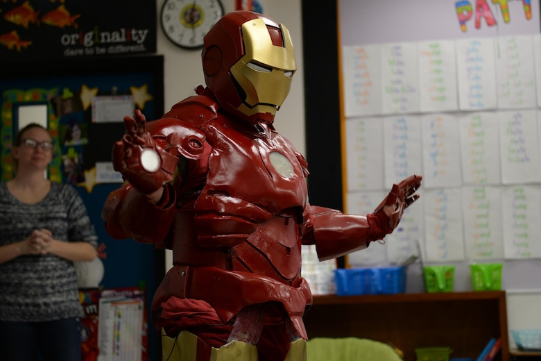Tech. Sgt. Brian Thornton in his homemade Iron Man suit, visits a classroom at Marrington Elementary Dec. 8, 2014, on Joint Base Charleston - Weapons Station, S.C. Thornton wears his Iron Man suit to local schools and hospitals hoping to help brighten children's days. Thornton is 628th Air Base Wing Air Defense Council paralegal. (U.S. Air Force photo/Senior Airman Christopher Reel)