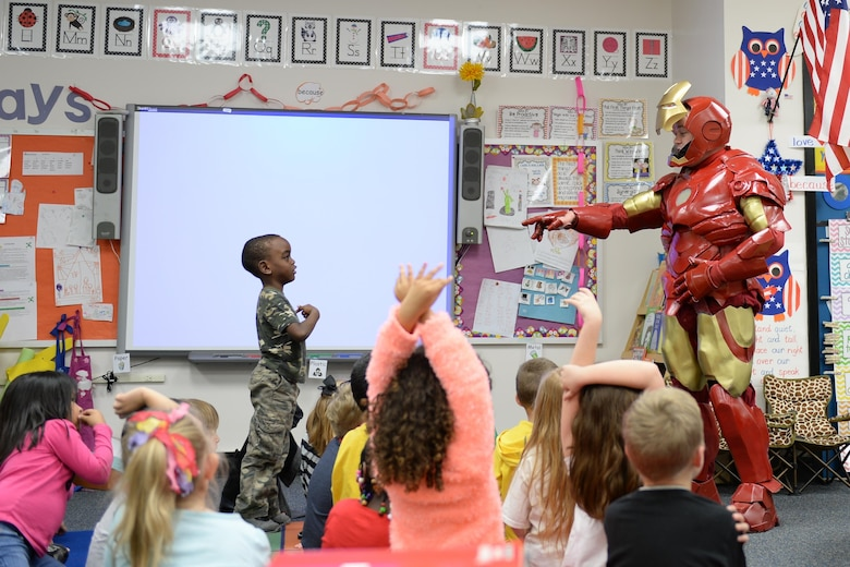 Tech. Sgt. Brian Thornton engages with children while dressed up in his homemade Iron Man suit  Dec. 8, 2014, at Marrington Elementary, Joint Base Charleston - Weapons Station, S.C. Thornton wears his Iron Man suit at local schools and hospitals hoping to help brighten a children's days. Thornton is a 628th Air Base Wing Air Defense Council paralegal.  (U.S. Air Force photo/Senior Airman Christopher Reel)