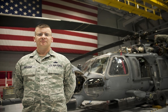 Tech. Sgt. Justin Mahana poses in front of an HH-60G Pave Hawk Jan. 20, 2015, at Nellis Air Force Base, Nev. On Jan. 6, 2015, Mahana pulled a middle-aged woman from a burning vehicle after overhearing her crash her SUV in a single-car accident in Lake Havasu, Ariz. Mahana is the 823rd Maintenance Squadron support section chief. (U.S. Air Force photo/Staff Sgt. Siuta B. Ika)