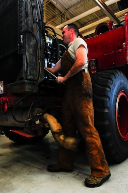 Staff Sgt. Nicholas Cawley, 1st Special Operations Logistics Readiness Squadron vehicle equipment journeyman, works on a fire truck at Hurlburt Filed, Fla., Jan. 21, 2015. The fire truck has been active since 1986, making it the oldest government vehicle on Hurlburt. (U.S. Air Force photo/Airman 1st Class Andrea Posey)