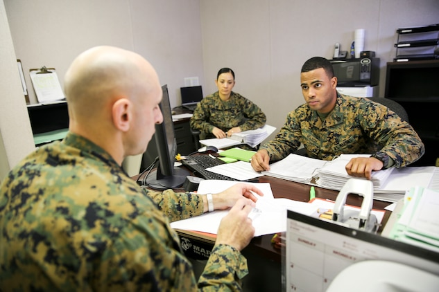 Master Sgt. Jason Spangenberg, 2nd Marine Aircraft Wing career planner, inspects the Marine Aviation Logistics Squadron 31 career planner Staff Sgt. Andrew Nelson during the commanding general inspection. CGIs review the unit in categories ranging from basic Marine Corps standards such as proper wear of uniforms, drill and physical fitness to standards specific to the unit.
