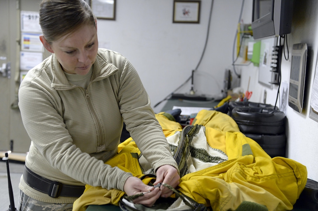 Staff Sgt. Lynette, launch and recovery supervisor, performs a quality assurance check on a full pressure suit at an undisclosed location in Southwest Asia Jan. 20, 2015. The suit is to protect the pilot from decompression sickness and is a backup in case the aircraft loses pressurization. Lynette is currently deployed from Beale Air Force Base, Calif., and is a native of Phillips, Maine. (U.S. Air Force photo/Tech. Sgt. Marie Brown)
