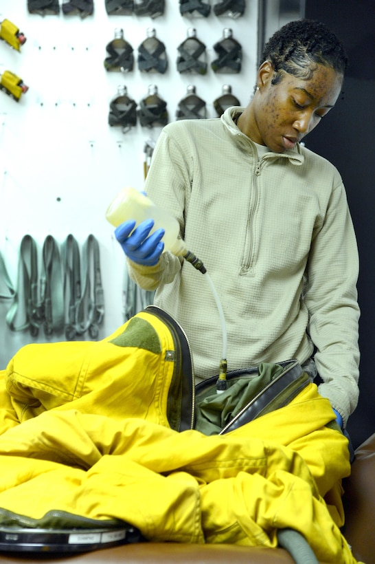 Senior Airman Andrea, launch and recovery technician, cleans a full pressure suit at an undisclosed location in Southwest Asia Jan. 20, 2015. The mission of the physiological support detachment is to inspect and maintain the full pressure suits necessary for the U-2 Dragon Lady pilot to survive above 50,000 feet and fly up to 70,000 feet. Andrea is currently deployed from Beale Air Force Base, Calif., and is a native of Centerville, Ga. (U.S. Air Force photo/Tech. Sgt. Marie Brown)