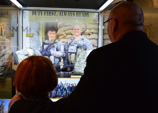 "DAYTON, Ohio -- Parents of SrA Smith view the ""Duty First, Always Ready"" exhibit where their son and SrA Malarsie are represented. This exhibit located in the Cold War Gallery at the National Museum of the U.S. Air Force, highlights the service of Senior Airmen Michael Malarsie and Bradley Smith, a two-man Joint Terminal Attack Controller (JTAC) who deployed together to Afghanistan in December 2009. (U.S. Air Force photo)"