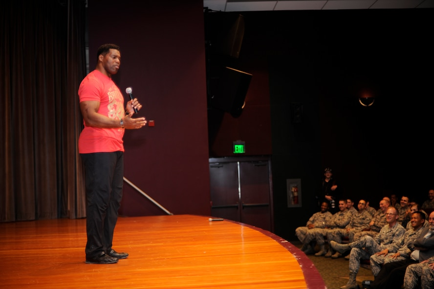 Herschel Walker, professional athlete and businessman, shares his story withTeam Vandenberg during an All Call, Jan. 21, 2015, Vandenberg Air Force Base, Calif. Walker visits military installations to share his personal story and raise unit morale. (U.S. Air Force photo by Staff Sgt. Jim Araos/Released)