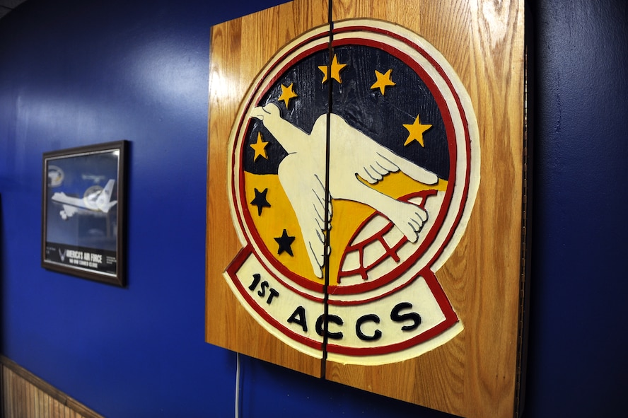 A hand-made, wooden dart board adorns the walls of the 1st Airborne Command Control Squadron's heritage room located in the 55th Operations Support Squadron building on Jan. 13, Offutt Air Force Base, Neb.  The dart board was donated to the heritage room from an Airman's father.  (U.S. Air Force photo by Josh Plueger/Released)