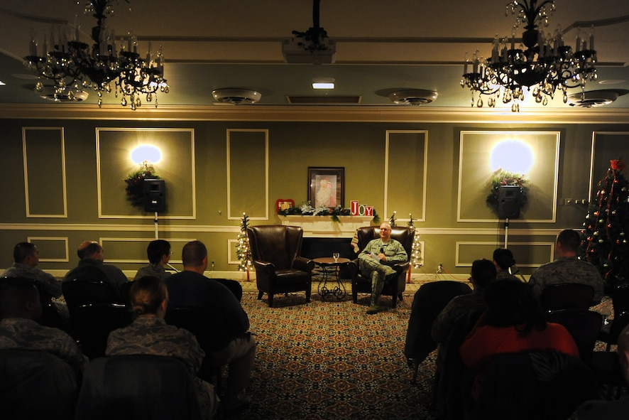 U.S. Air Force Tech. Sgt. Travis Williams, 55th Comptroller Squadron, sits in front of fellow Airman of Team Offutt while speaking about his experiences in a special duty assignment during the inaugural Story Tellers event called 'The Long and Short of it' held on Dec. 16 at the Patriot Club on Offutt Air Force Base, Neb. Williams stressed the importance of stepping outside of your comfort zone by looking into special duty assignments that the Air Force offers.  (U.S. Air Force photo by Josh Plueger/Released)