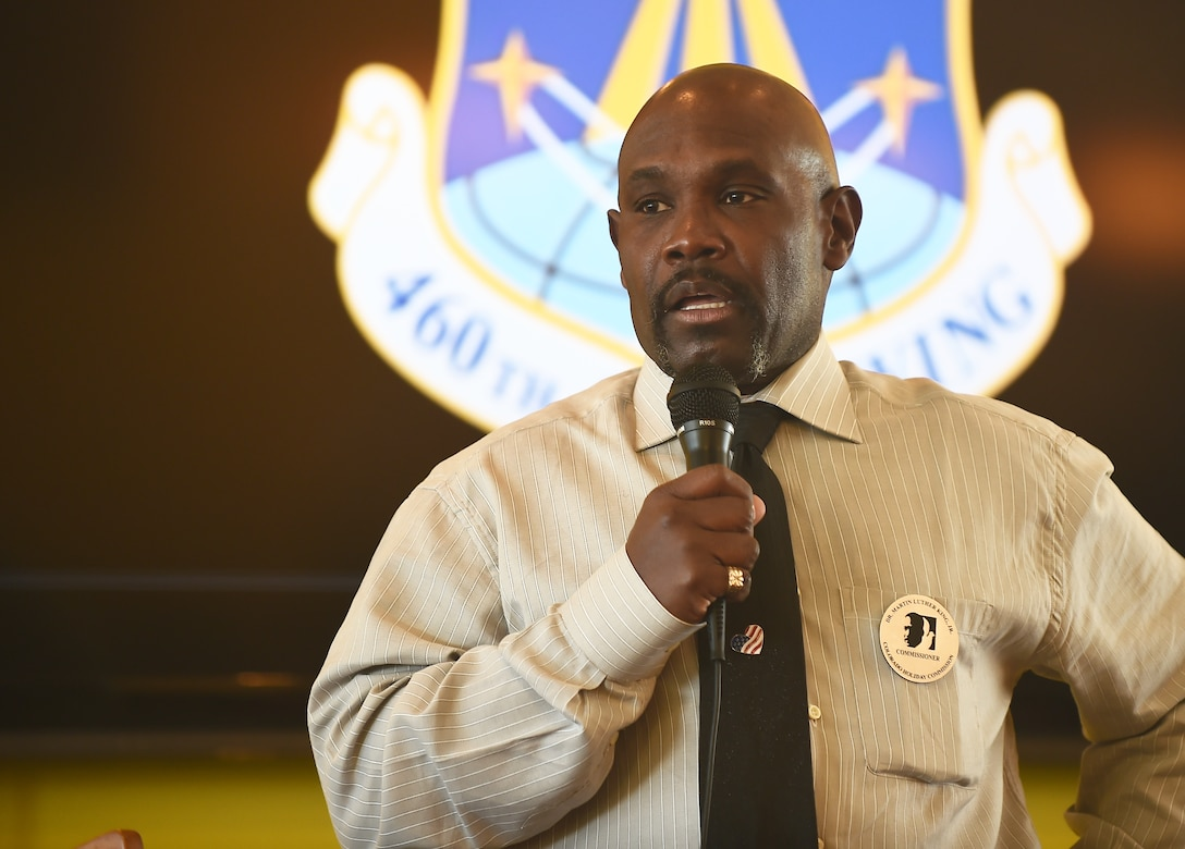 Vern L. Howard, Martin Luther King Colorado Holiday Commission chairman, spoke Jan. 22, 2015, at the Panther Den on Buckley AFB, Colo., to commemorate Dr. Martin Luther King Jr. Howard spoke of the trials and tribulations MLK triumphed through when striving for equal rights. (U.S. Air Force photo by Airman 1st Class Luke Nowakowski/Released)