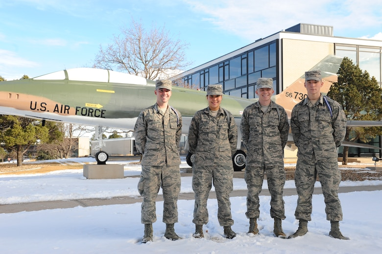 Academy Preparatory School Cadet Candidates Chad E. Chreene II (left), Caitlin Stewart-Moore, Joseph Kloc and Jared Kreuzer stand outside the Prep School Jan. 16, 2015. All four cadet candidates earned 4.0 GPAs for the second quarter of the academic year. (U.S. Air Force photo/Airman 1st Class Rachel Hammes)