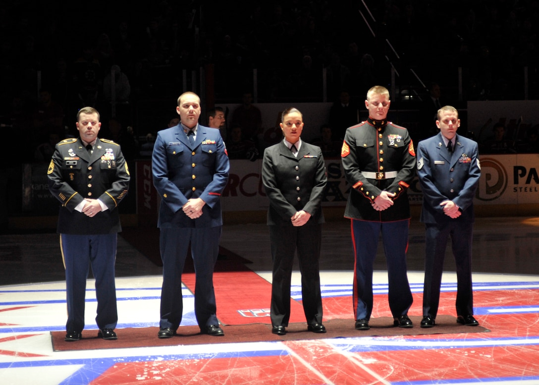 Personnel from all military branches gather at the Spokane Arena during a Spokane Chiefs hockey game Jan. 24, 2015, in Spokane Wash. The military members were selected to ceremoniously drop the puck during Military Appreciation Night. (U.S. Air Force photo/Airman 1st Class Taylor Bourgeous)