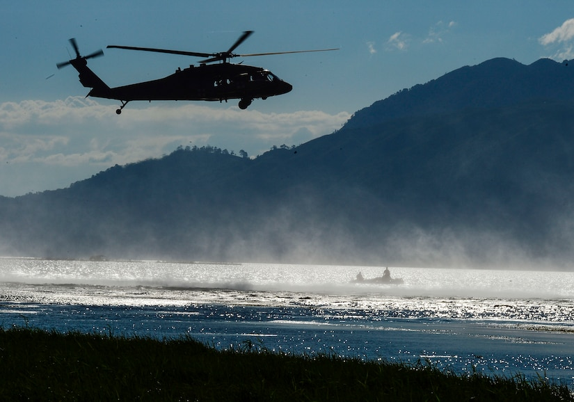 A UH-60 Black Hawk helicopter assigned to the 1-228th Aviation Regiment hovers over U.S. Army Special Operations members during over water hoist training at Lake Yojoa, Honduras, Jan. 22, 2015.   The 1-228th Aviation Regiment partnered with U.S. Army Special Operations personnel to practice recovering live personnel. The overwater hoist training was held to ensure members of Joint Task Force-Bravo are planning and preparing for crisis and contingency response, as well as countering transnational organized crime, and counterterrorism operations as part of U.S. Southern Command's mission. Contingency planning prepares the command for various scenarios that pose the greatest probability of challenging our regional partners or threatening our national interests. (U.S. Air Force photo/Tech. Sgt. Heather Redman)
