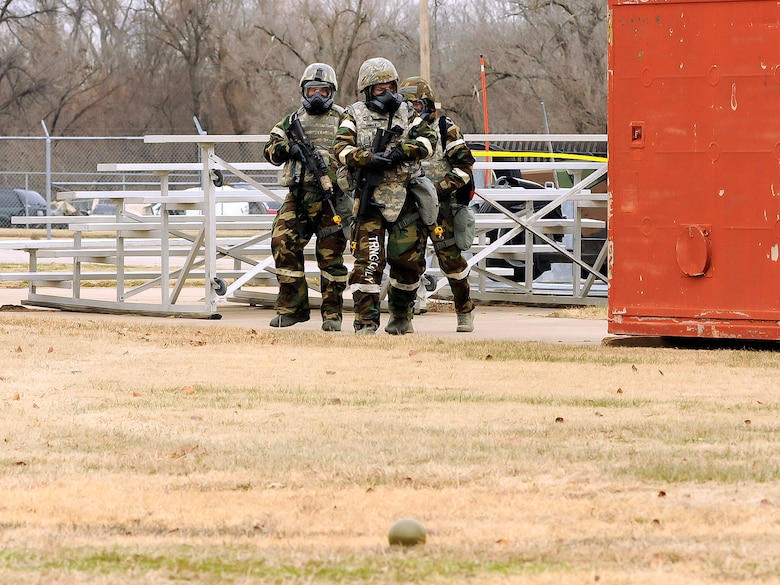 Members of the 138th Security Forces post attack reconnaissance team encounter an unexploded ordinance (UXO) while conducting a sweep around their assigned post during an exercise held on January 10, 2015, at the 138th Fighter Wing.  Tulsa Air National Guard members participated in refresher force protection training to reinforce chemical, biological and self-buddy aid practices.  (U.S. National Guard photo by Tech Sgt. Roberta A. Thompson/Released)
