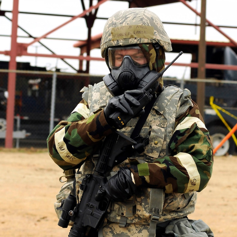 Staff Sgt. Randal Arnold, 138th Security Forces, reports information of an unexploded ordinance found while conducting a post attack reconnaissance, during a wing exercise on January 10, 2015, at the 138th Fighter Wing.  Tulsa Air National Guard members participated in refresher force protection training to reinforce chemical, biological and self-buddy aid practices.  (U.S. National Guard photo by Tech. Sgt. Roberta A. Thompson/Released)