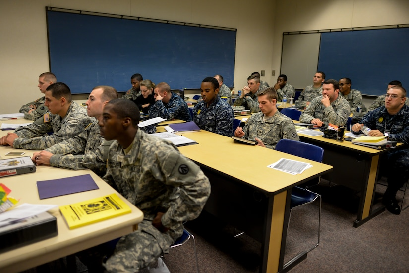 Soldiers, Sailors and Airmen take notes on litter procedures Jan. 22, 2015, at Joint Base Charleston, S.C., during a joint service Combat Lifesaver Course.  The event was hosted by Soldiers stationed at Fort Jackson, S.C. Forty-three students participated in the course, which is designed to teach lifesaving skills to non-medical military personnel. The course is 40 hours long and incorporates classroom and practical training. (U.S. Air Force photo/Senior Airman Jared Trimarchi)