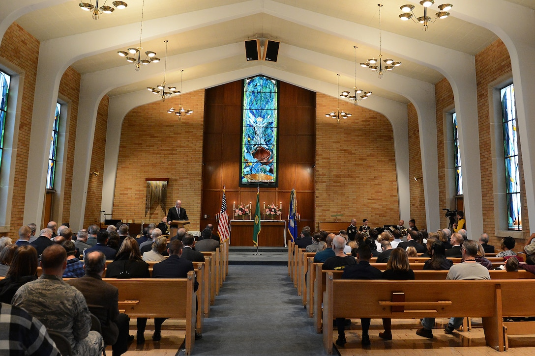 Chaplain Gary Cowden speaks during a Purple Heart ceremony for Staff Sgt. John Campbell, Air Force veteran, Jan. 25, 2015 at American Lake Chapel, Tacoma, Wash.  Campbell served in the Air Force from July 1966 to July 1970. He received the Purple Heart for injuries he sustained during an attack Jan. 1, 1970 in Laos. (U.S. Air Force photo\ Staff Sgt. Tim Chacon)