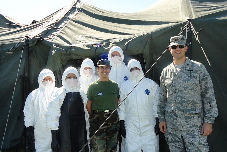 Maj. Brian Neese, 12th Air Force (Air Forces Southern), chief of international health specialists division, smiles with members after their successful completion of a final capstone exercise, aimed at testing their knowledge and ability to adapt in a timely manner to the Ebola virus on Dec. 06, 2014, in El Salvador. There are many Latin American countries that support United Nations peace keeping operations, and the training given to the El Salvadorans, Guatemalans, and Uruguayans will have an impact on those they train, as well as the individuals their able to assist. (Courtesy Photo)