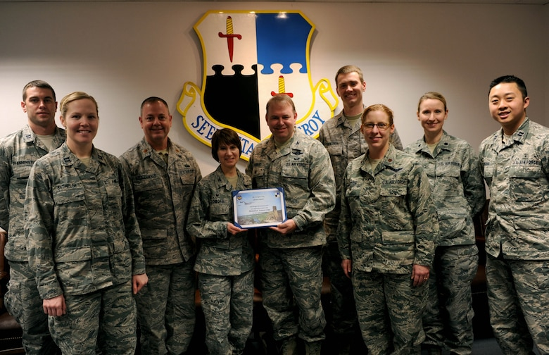 U.S. Air Force Col. Lars Hubert, 52nd Fighter Wing acting commander, center right, holds up a certificate designating Jan. 26-30, 2015, as Biomedical Science Corps Appreciation Week with U.S. Air Force Col. Jill Scheckel, 52nd Medical Group commander, center left, along with 52nd MDG Airmen in the wing conference room at Spangdahlem Air Base, Germany, Jan. 21, 2015. The BSC comprises career fields such as physical and occupational therapy; optometry; podiatry; physician assistants; audiology and speech pathology; clinical psychology; clinical social work; aerospace and operational physiology; dietetics; bioenvironmental engineers; public health; medical entomology; pharmacy; biomedical laboratory; healthcare facilities architects and engineers; and health and medical physics. (U.S. Air Force photo by Airman 1st Class Timothy Kim/Released)