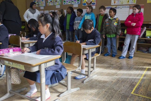 Children and staff from the School Age Care center aboard Marine Corps Air Station Iwakuni, Japan, observe the classes at Nishiki Seiryu Elementary School in Iwakuni City, Jan. 23, 2015. SAC visited the school to compare Japanese and American schooling.