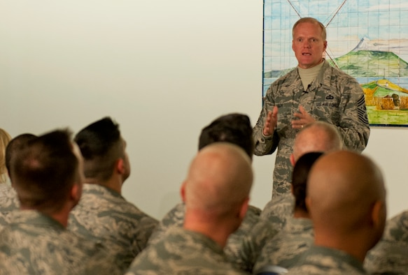 Chief Master Sgt. of the Air Force James A. Cody speaks to Airmen during an all call Jan. 26, 2015 at the 65th Air Base Wing, Lajes Field, Azores, Portugal . Cody is currently on a tour of bases within the United States Air Forces in Europe command to express his gratitude to Airmen, listen to their concerns and answer their questions. (U.S. Air Force photo/Staff Sgt. Zachary Wolf)