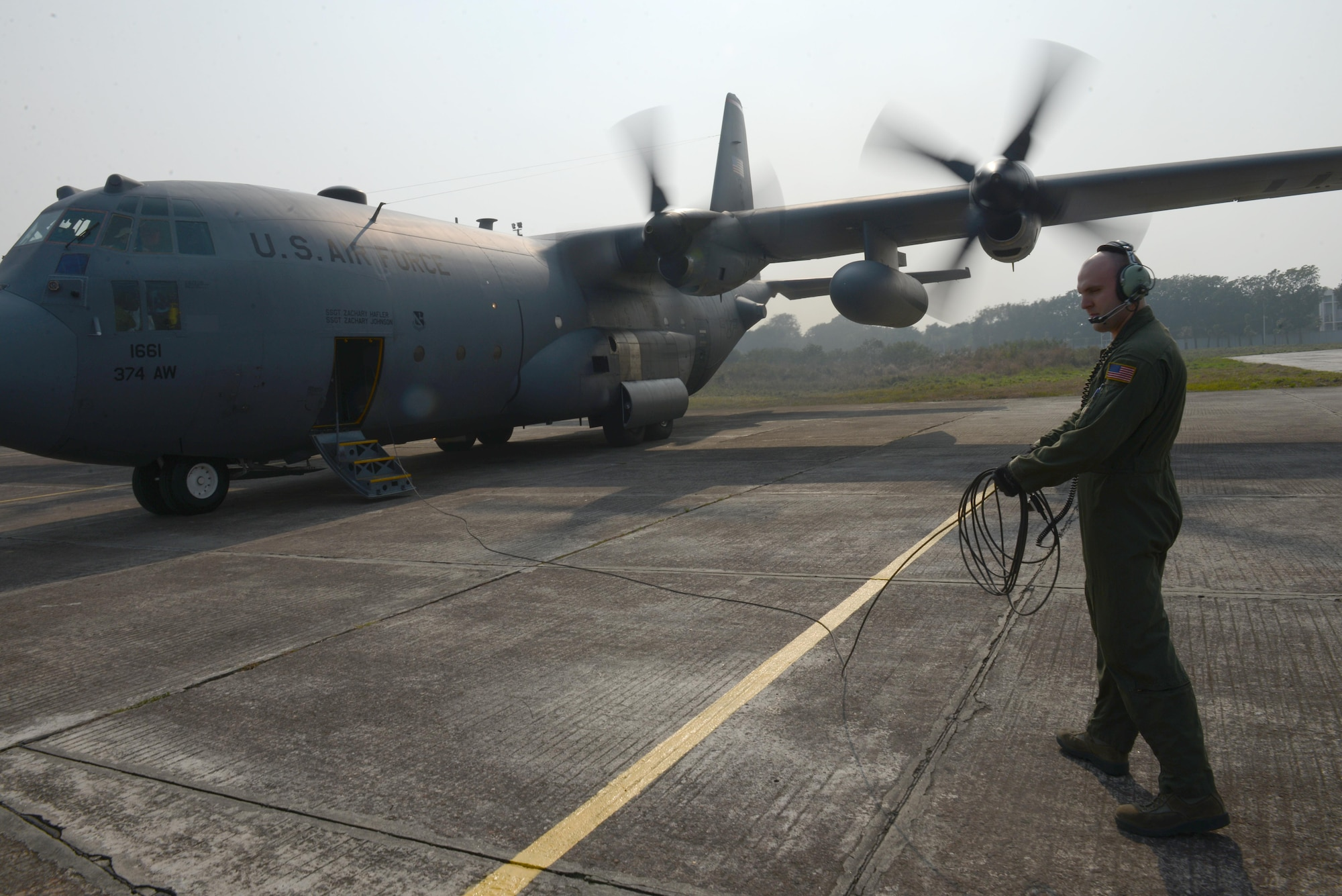 Staff Sgt. Noel Jones prepares to board a C-130H aircraft after engines start Jan. 24, 2015 during exercise Cope South at Bangladesh air force base, Bangabandhu, Bangladesh. Cope South helps cultivate common bonds, foster goodwill, and improve readiness and compatibility between members of the Bangladesh and U.S. Air Forces. Jones is a loadmaster assigned to the 36th Airlift Squadron, Yokota Air Base, Japan.  (U.S. Air Force photo/1st Lt. Jake Bailey)