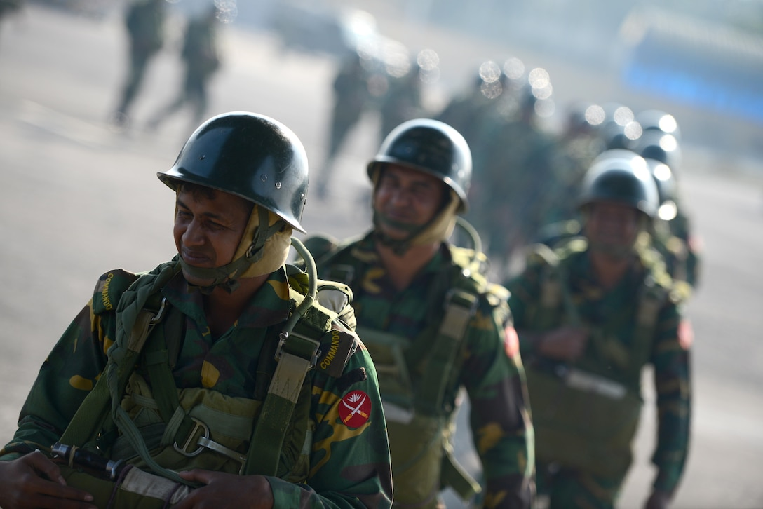 Bangladeshi commandos board a U.S. Air Force C-130H aircraft at Sylhet International Airport, Bangladesh, before conducting a personnel airdrop mission  Jan. 24, 2015 during exercise Cope South. The exercise helps cultivate common bonds, foster goodwill, and improve readiness and compatibility between members of the Bangladesh and U.S. Air Forces. (U.S. Air Force photo/1st Lt. Jake Bailey)