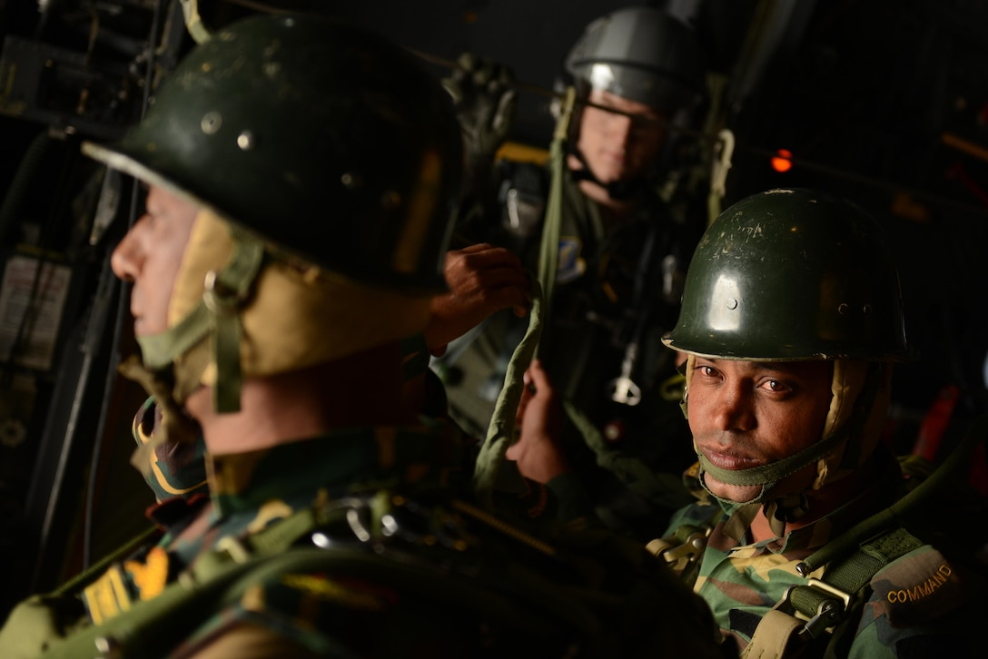 Bangladeshi commandos prepare to jump from a U.S. Air Force C-130H aircraft Jan. 24, 2015 during exercise Cope South near Sylhet, Bangladesh. The exercise helps cultivate common bonds, foster goodwill, and improve readiness and compatibility between members of the Bangladesh and U.S. Air Forces. (U.S. Air Force photo/1st Lt. Jake Bailey)