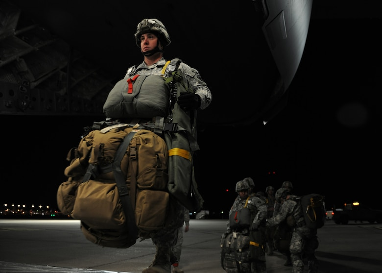 An Army National Guard Soldier walks up the cargo ramp of a C-17 Globemaster III cargo aircraft Jan. 23, 2015, in Austin, Texas. Many of the Soldiers' gear weighed up to 95 pounds. The Soldier is from the 1st Battalion, 143rd Infantry Regiment. (U.S. Air Force photo/Airman 1st Class Nathan Clark)