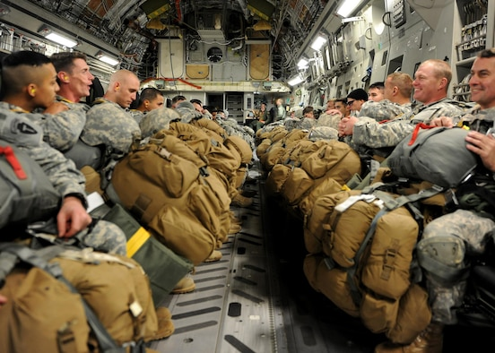 Army National Guard Soldiers wait in the cargo hold of a C-17 Globemaster III cargo aircraft before taking off for a training jump Jan. 23, 2015, in Austin, Texas. The Soldiers jumped from the aircraft using a static line method which deploys their chutes immediately as they exit the aircraft. The Soldiers are from the 1st Battalion, 143rd Infantry Regiment. (U.S. Air Force photo/Airman 1st Class Nathan Clark)
