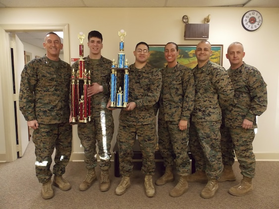 Training and Education Command Commanding General, Maj. Gen. James W. Lukeman and Sergeant Major, Sgt. Maj. Justin D. LeHew, stand with members of the 2014 TECOM intramural volleyball championship team. Pictured from left to right are Sgt. Joseph Battaglia, Cpl. Francisco Gonzalez, Cpl. Ashely Latterner, and Team Captain Maj. Brian Trievel. Not pictured: Capt. Luke Balthazar, Sgt. Justin Borszem, Sgt. Jose Ramirez, Sgt. Jonathan Harris, Cpl. Sean Youdis, Cpl. James Willis, Cpl. Adam Hindes, Lance Cpl. Shane Bristolaldrich, Pfc. Omri Blair, and Mr. Moses Saucedo.