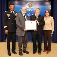William Goran, formerly of ERDC-CERL, receives the 2014 GreenGov Climate Champion Award.  Pictured are Lt. Gen. Thomas P. Bostick, USACE chief of engineers and commanding general, Goran, Sam Higuchi of NASA and Assistant Secretary of the Army (Civil Works) Jo-Ellen Darcy.