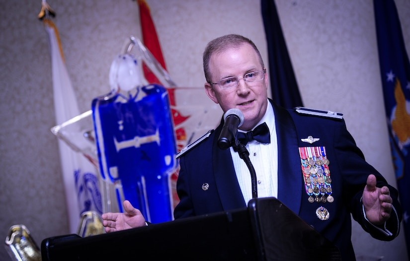 Col. Jeffrey DeVore, Joint Base Charleston commander, speaks to an audience of Airmen and Sailors Jan. 23, 2015, at the 2015 628th Air Base Wing Annual Awards Banquet at the Charleston Club on Joint Base Charleston, S.C. (U.S. Air Force photo/Airman 1st Class Clayton Cupit)