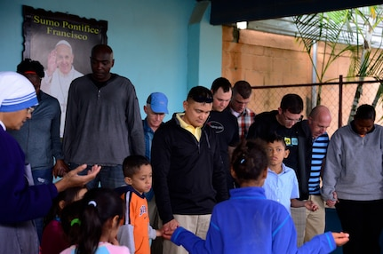 Members of Joint Task Force-Bravo gather to pray with the people living at the Sisters of Charity Orphanage in Comayagua, Honduras, Jan. 25, 2015. The Sisters of Charity Orphanage is one of seven different orphanages from around the Comayagua Valley that the U.S. military personnel assigned to JTF-Bravo have supported over the past 17 years. In addition to spending time with interacting with children, members have also collected and donated much-needed supplies and food, as well as helped in minor construction work on the buildings in which the children live. (U.S. Air Force photo/Tech. Sgt. Heather Redman)