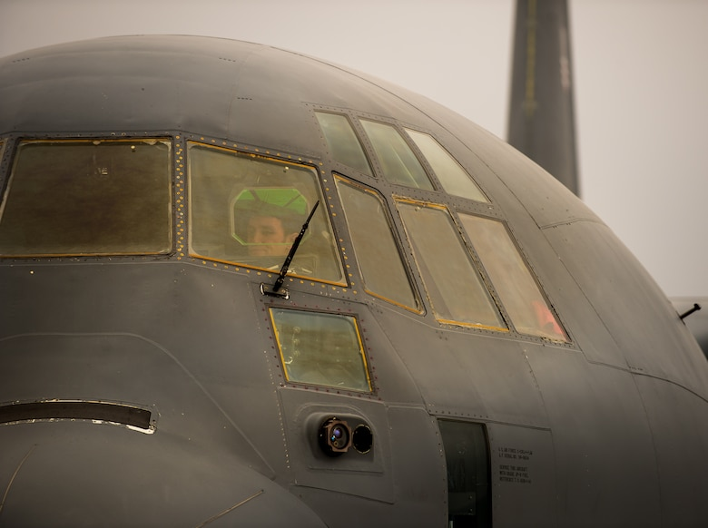 Capt. Kenneth Jubb, 37th Airlift Squadron pilot, performs pre-flight checks in a C-130J Super Hercules for a training mission Jan. 22, 2015, at Ramstein Air Base, Germany. Using its loading ramp and door, the C-130 can accommodate a wide variety of oversized cargo, including everything from utility helicopters and six-wheeled armored vehicles to standard palletized cargo and military personnel. (U.S. Air Force photo/Senior Airman Jonathan Stefanko)
