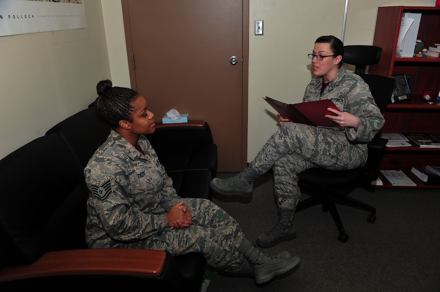 Staff Sgt. Jeannie Hackett, 51st Medical Operations Squadron, certified alcohol and drug counselor, speaks with Tech. Sgt. La'Kisha Tucker, 51st MDOS alcohol and drug abuse prevention and treatment NCO in charge, about how to handle work a case when taking it to the next appropriate level of care Jan. 9, 2014, at Osan Air Base, Republic of Korea. Hackett is this week's Airman Spotlight winner. (U.S. Air Force photo by Senior Airman David Owsianka)