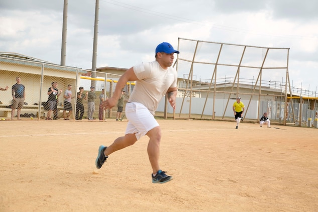 Staff Sgt. Jonathon Campos, from Los Angeles, California, sprints toward second base during a friendly softball game with members of the Henoko Young Men's Association Jan. 25 on Camp Schwab. Softball games between U.S. Marines and the Henoko Young Men's Association has been a tradition for two decades. Campos is a platoon sergeant with 3rd Battalion, 3rd Marine Regiment, currently assigned to 4th Marine Regiment, 3rd Marine Division, III Marine Expeditionary Force under the unit deployment program.