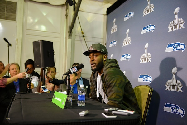 Kam Chancellor, a defensive back for the National Football League's defending champion Seattle Seahawks, talks to members of the media during Super Bowl Week in Glendale, Ariz., Jan. 26, 2015. Chancellor gave a shoutout to U.S. troops serving abroad who will be watching the NFL's championship game. DoD photo by Army Sgt. 1st Class Tyrone C. Marshall Jr.