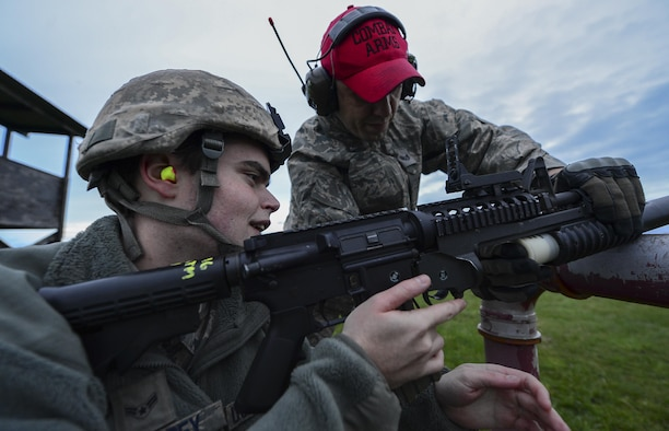Staff Sgt. Alan Daly gives range correction instructions to Airman 1st Class Brennan Eisenbrey during an M203 grenade launcher qualification course Dec. 12, 2014, at Royal Air Force Feltwell, England. Combat arms training and maintenance instructors ensure the safe and effective operation of weapon systems. Daly is a 48th Security Forces Squadron combat arms instructor and Eisenbrey is a 48th SFS response force member. (U.S. Air Force photo/Airman 1st Class Erin R. Babis)