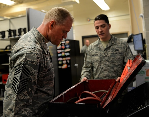 Senior Airman Matthew Binstock speaks to Chief Master Sgt. of the Air Force James A. Cody about the functions of a flap swing Jan. 23, 2015, at Barksdale Air Force Base, La. Maintenance Airmen use flap swings to install and remove B-52H Stratofortress aircraft wing flaps. Binstock is a 2nd Maintenance Squadron phase inspection journeyman. (U.S. Air Force photo/Airman 1st Class Curt Beach)