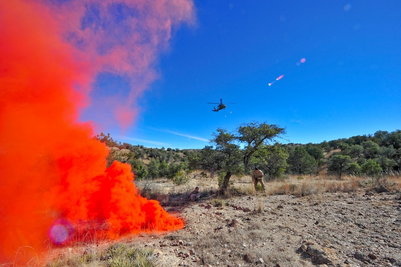 An Arizona Army National Guard UH-60A Black Hawk helicopter from Detachment 1, C Company, 5-159th Air Ambulance, based out of Phoenix, approaches simulated downed pilots after spotting smoke from simulated downed pilots during joint training at a southern Arizona military training range, Jan. 20, 2015.  The joint training consisted of A-10C Thunderbolt IIs from the 354th Fighter Squadron, based out of Davis-Monthan Air Force Base, and the UH-60A Black Hawk helicopter from Detachment 1, C Company, 5-159th Air Ambulance, based out of Phoenix, conducting close air support and combat search and rescue exercises.  (U.S. Air Force Photo by Airman 1st Class Chris Massey/Released)
