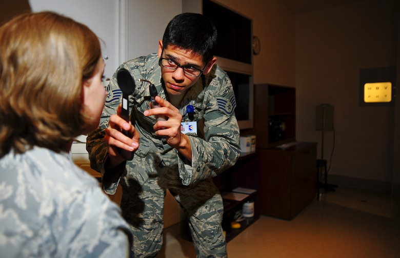 U.S. Air Force Staff. Sgt. Nick DeLong, 355th Aerospace Medicine Squadron optometry NCO in charge, performs a cover test on a patient at Davis-Monthan Air Force Base, Ariz., Jan. 28, 2015.  There are 2,400 officers, and 5,800 enlisted members in parallel career fields that encompass the Biomedical Sciences Corps. (U.S. Air Force photo by Staff Sgt. Angela Ruiz)