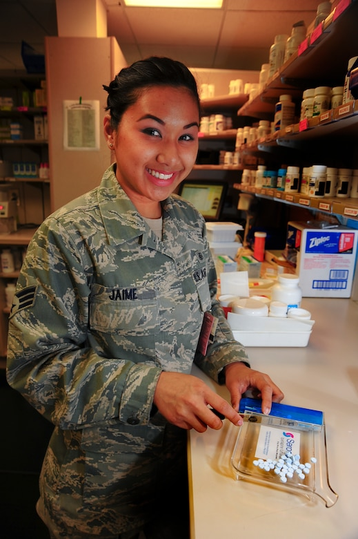 U.S. Air Force Senior Airman Alexa Jane Jaime, 355th Medical Support Squadron pharmacy technician, counts pills for a prescription at Davis-Monthan Air Force Base, Ariz., Jan. 28, 2015.  The 355th Medical Group is celebrating the 50th anniversary of the Biomedical Sciences Corps this week.  (U.S. Air Force photo by Staff Sgt. Angela Ruiz)