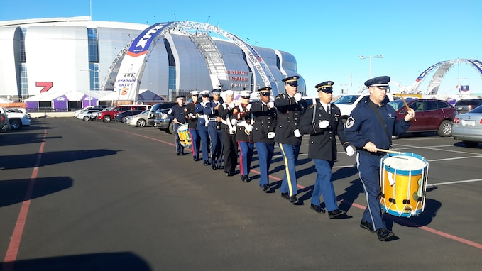 Senior Master Sgt. Chris Martin and Master Sgt. Tom Rarick rehearse with a Joint Service Honor Guard outside of the University of Phoenix Stadium. The group later performed for the opening ceremony at the Pro Bowl during the national anthem, January 25th. (U.S. Air Force Photo)
