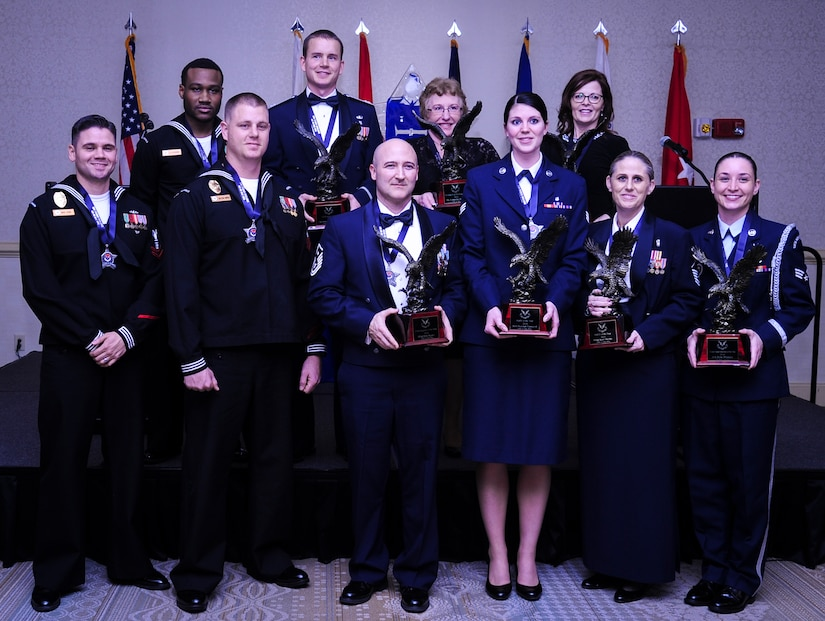 The 628th Air Base Wing held its 2014 Annual Awards ceremony Jan. 23, 2015 at the Charleston Club on Joint Base Charleston, S.C. Winners are (from back left)  Logistics Specialist 3rd Class Delmetrius Blanding, Naval Support Activity, Blue Jacket of the Year; Capt. Joshua Van Wyngaarden, 628th Medical Operations Squadron, Company Grade Officer of the Year; Catherine Hallett, 628th MDOS, Civilian Category II of the Year; Ms. Anna Urrutia, 628th Contracting Squadron, Civilian Category III of the Year; (from front left) Master at Arms 2nd Class Brian Cobb, NSA, Junior Sailor of the Year; Master at Arms 1st Class Mark VanWyck, NSA, Senior Sailor of the Year; Master Sgt. Eric Rainer, 628th Medical Group, First Sergeant of the Year; Senior Airman Hannah Leonard, 628th Aerospace Medicine Squadron, Airman of the Year; Master Sgt. Kari Boyles, 628th AMDS, SNCO of the Year and Senior Airman Erin Winkler, 437th Aircraft Maintenance Squadron, Honor Guard Member of the Year. Not pictured is Phillip Hull, 628th Security Forces Squadron, Civilian Category I and Tech. Sgt. Toriano Banks, 628th Comptroller Squadron, NCO of the year. (U.S. Air Force photo/Airman 1st Class Clayton Cupit)