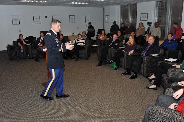 U.S. Army Corps of Engineers Nashville District Commander Lt. Col John L. Hudson talks with attendees and 2014 graduates of the Leadership Development Program class Jan. 26, 2015 at the Scarlett Leadership Institute in Franklin, Tenn.